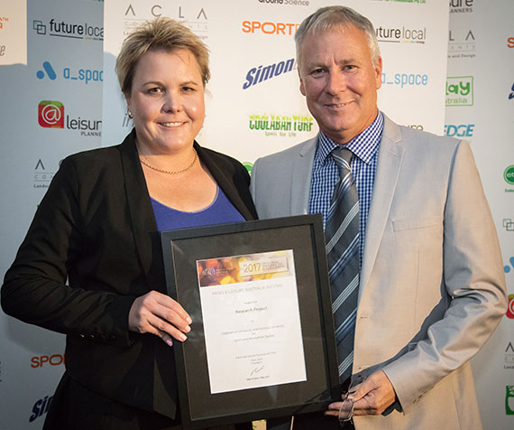 Associate Professor Rochelle Eime accepting the Parks and Leisure Australia Award of Excellence in the Research Project category