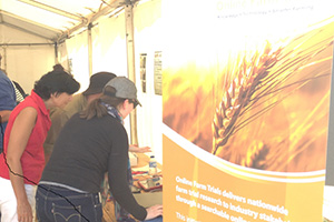 A photo of CeRDI's Angela Murphy and Jennifer Corbett discussing OFT research at a recent farming event in Victoria